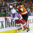 Philadelphia Flyers' Luke Schenn, right, collides with New York Rangers' Ryan Bourque during the first period of a preseason NHL hockey game, Tuesday, Sept. 30, 2014, in Philadelphia The Associated Press