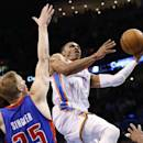 Oklahoma City Thunder guard Russell Westbrook (0) shoots in front of Detroit Pistons guard Kyle Singler (25) during the fourth quarter of an NBA basketball game in Oklahoma City, Wednesday, April 16, 2014. Oklahoma City won 112-111. (AP Photo/Sue Ogrocki)