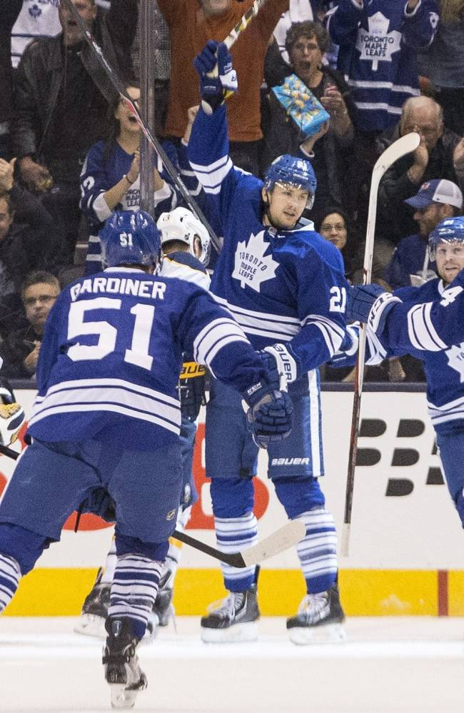 Toronto Maple Leafs' James van Riemsdyk, center, celebrates after scoring his team's opening goal against Buffalo Sabres during the first period of an NHL hockey game, Saturday, Nov. 16, 2013