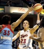 Indiana Fever guard Katie Douglas (23) shoots over Atlanta Dream defender Angel McCoughtry during the second half of a WNBA basketball first-round playoff game in Indianapolis, Tuesday, Oct. 2, 2012. The Fever won 75-64. (AP Photo/AJ Mast)