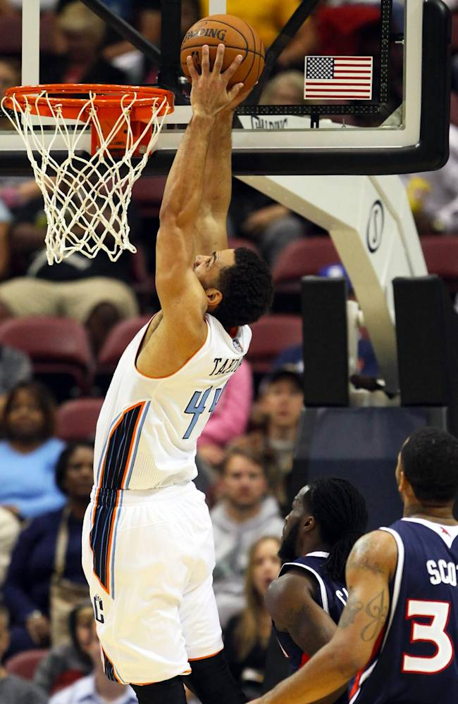 Charlotte Bobcats forward Jeffery Taylor, left, drives to the basket during the first half of a preseason NBA basketball game against Atlanta Hawks in Asheville, N.C., Tuesday, Oct. 8, 2013
