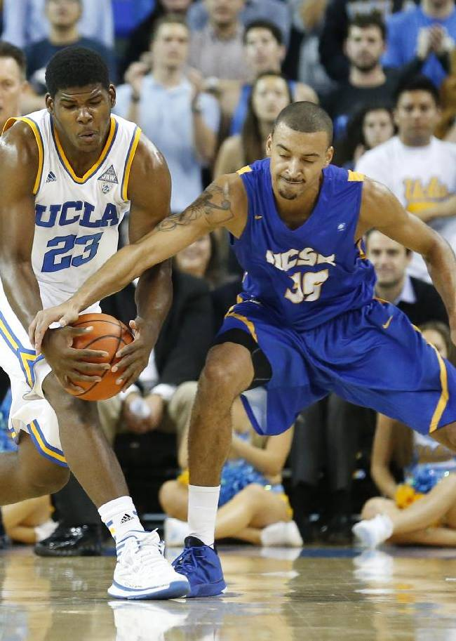 UCLA's Tony Parker, left, grabs the ball away from UC Santa Barbara's Taran Brown, right, during the second half of an NCAA college basketball game, Tuesday, Dec. 3, 2013, in Los Angeles. UCLA won 89-76