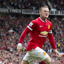 Manchester United's Wayne Rooney celebrates after scoring against Swansea City during their English Premier League soccer match at Old Trafford Stadium, Manchester, England, Saturday Aug. 16, 2014