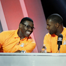 Michael Irvin, left, talks to Dallas Cowboys' DeMarco Murray during the Pro Bowl draft Wednesday, Jan. 21, 2015, in Phoenix The Associated Press