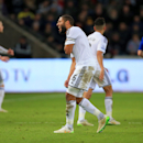 Swansea City's Ashley Williams pulls up with an injury during their English Premier League soccer match against Chelsea at the Liberty Stadium, Swansea, Wales, Saturday, Jan. 17, 2015