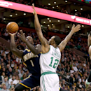 Indiana Pacers shooting guard Lance Stephenson (1) shoots against the defense of Boston Celtics small forward Chris Johnson (12) during the first half of an NBA basketball game on Saturday, March 1, 2014, in Boston The Associated Press