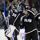 Tampa Bay Lightning center Valtteri Filppula (51), of Finland, celebrates with goalie Ben Bishop (30) after the Lightning defeated the New York Islanders 5-2 during an NHL hockey game Saturday, Nov. 15, 2014, in Tampa, Fla The Associated Press