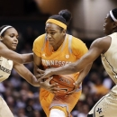Tennessee guard Ariel Massengale, center, drives between Vanderbilt's Christina Foggie (10) and Tiffany Clarke (34) during the first half of an NCAA college basketball game, Thursday, Jan. 24, 2013, in Nashville, Tenn. (AP Photo/Mark Humphrey)