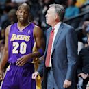 Los Angeles Lakers guard Jodie Meeks, left, confers with head coach Mike D'Antoni while facing the Denver Nuggets in the first quarter of an NBA basketball game in Denver on Wednesday, Nov. 13, 2013 The Associated Press
