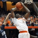 Syracuse's Jerami Grant takes the ball to the basket against Villanova during the second half of an NCAA college basketball game in Syracuse, N.Y., Saturday, Jan. 12, 2013. Syracuse won 72-61. (AP Photo/Kevin Rivoli)