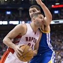 Toronto Raptors' Greivis Vasquez, left, drives against Golden State Warriors' Klay Thompson during the first half of an NBA basketball game Sunday, March 2, 2014, in Toronto The Associated Press