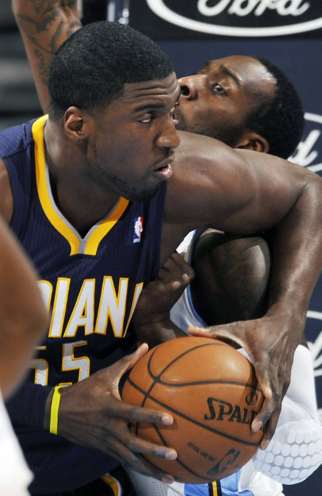 Indiana Pacers center Roy Hibbert (55) knocks Denver Nuggets center J.J. Hickson (7) out of the way during the first quarter of an NBA basketball game Saturday, Jan. 25, 2014, in Denver