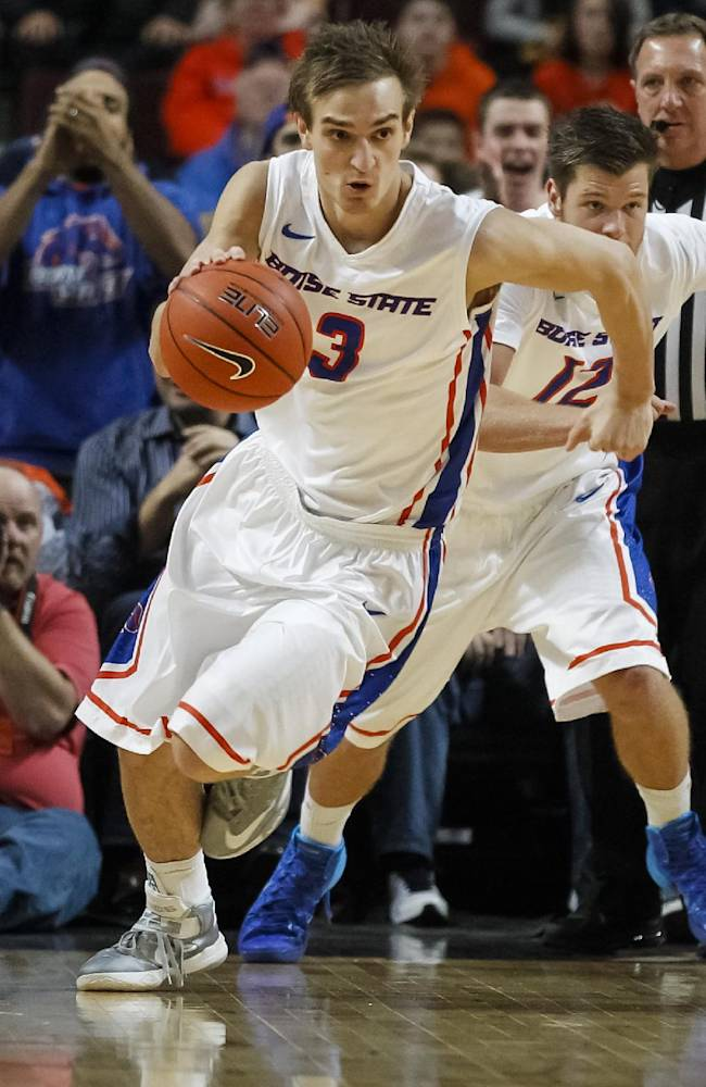 Boise State's Anthony Drmic (3) drives the ball upcourt during the first half of an NCAA college basketball game against Idaho in Boise, Idaho, Wednesday, Nov. 27, 2013