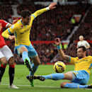 Crystal Palace's Damien Delaney, center, wins the ball ahead of Manchester United's Adnan Januzaj, left, during their English Premier League soccer match at Old Trafford, Manchester, England, Saturday, Nov. 8, 2014