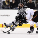 Los Angeles Kings center Jeff Carter, left, is pulled down by Anaheim Ducks center Ryan Getzlaf during the third period of an NHL hockey game, Saturday, April 12, 2014, in Los Angeles The Associated Press