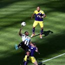 Newcastle United's Shola Ameobi, left, vies for the ball with Swansea City's Jordi Amat, center, and Ashley Williams, right, during their English Premier League soccer match at St James' Park, Newcastle, England, Saturday, April 19, 2014