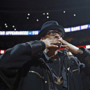 Former Philadelphia 76ers' Allen Iverson blows a kiss to the crowd during a retirement ceremony at half-time of an NBA basketball game between the Philadelphia 76ers and the Washington Wizards, Saturday, March 1, 2014, in Philadelphia. (AP Photo/Matt Slocum)