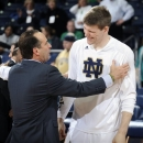 Notre Dame head coach Mike Brey, left, talks with forward Jack Cooley during senior class ceremonies prior to an NCAA college basketball game against St. John's on Tuesday, March 5, 2013 in South Bend, Ind. (AP Photo/Joe Raymond)