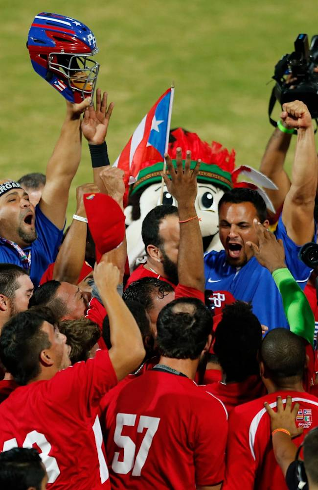Puerto Rico's players celebrate after they defeated Venezuela 2-0 during a Caribbean Series baseball semifinal game in Porlamar, Venezuela, Friday, Feb. 7, 2014. Puerto Rico will face Mexico at the final