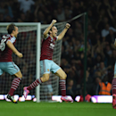 West Ham United's Stewart Downing, centre, celebrates setting up his team's third goal during their English Premier League soccer match against Liverpool at Upton Park, London, Saturday, Sept. 20, 2014