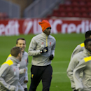 Liverpool's Mario Balotelli, center, trains with teammates at Anfield Stadium, in Liverpool, England, Tuesday, Oct. 21, 2014. Liverpool will play Real Madrid in a Champion's League Group B soccer match on Wednesday