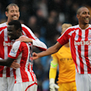 Stoke City's Peter Crouch, left, with Mame Diouff and Steven N'Zonzi, right, celebrate after their English Premier League soccer match against Manchester City at the Etihad Stadium in Manchester, England, Saturday Aug. 30, 2014. (AP Photo / Lynne Cameron,