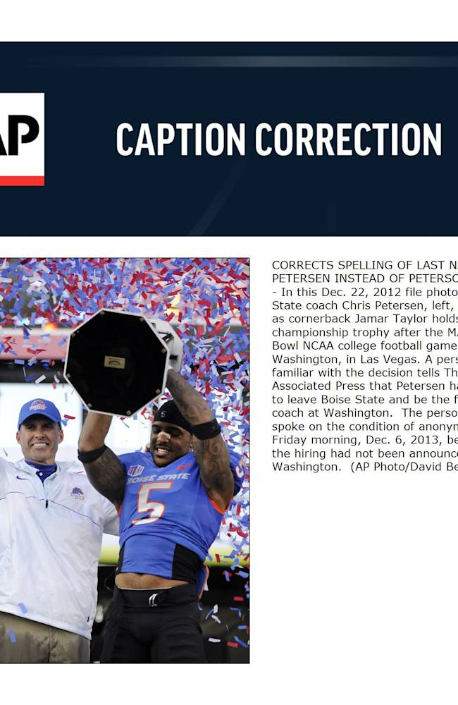 In this Dec. 22, 2012 file photo, Boise State coach Chris Petersen, left, gestures as cornerback Jamar Taylor holds the championship trophy after the MAACO Bowl NCAA college football game against Washington, in Las Vegas. A person familiar with the decision tells The Associated Press that Petersen has agreed to leave Boise State and be the football coach at Washington.  The person told spoke on the condition of anonymity Friday morning, Dec. 6, 2013, because the hiring had not been announced by Washington