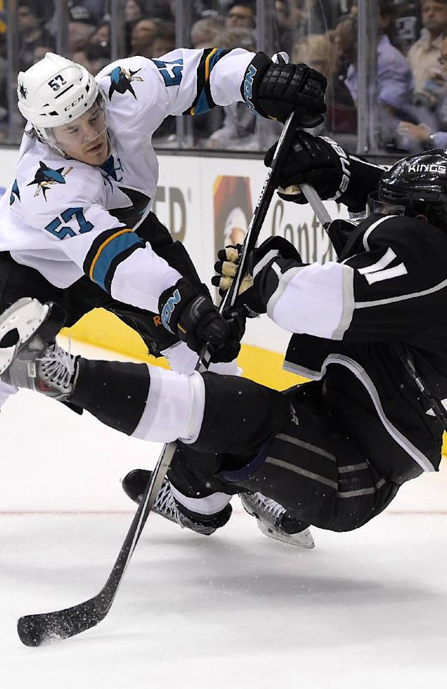 San Jose Sharks center Tommy Wingels, left, pushes down Los Angeles Kings center Anze Kopitar, of Slovenia, during the third period in Game 6 of an NHL hockey first-round playoff series, Monday, April 28, 2014, in Los Angeles. The Kings won 4-1. (AP Photo)