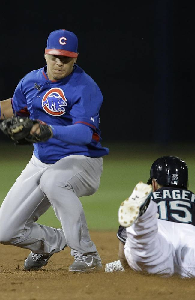 Seattle Mariners' Kyle Seager steals second before being tagged by Chicago Cubs shortstop Javier Baez during the first inning of a spring exhibition baseball game Wednesday, March 12, 2014, in Peoria, Ariz
