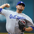 Los Angeles Dodgers starting pitcher Ricky Nolasco throws to a Colorado Rockies batter during the first inning of a baseball game, Tuesday, Sept. 3, 2013, in Denver. (AP Photo/Jack Dempsey)