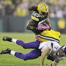 Minnesota Vikings' Christian Ponder (7) tackles Green Bay Packers' Jamari Lattimore (57) after Lattimore intercepted a pass during the first half of an NFL football game Thursday, Oct. 2, 2014, in Green Bay, Wis The Associated Press