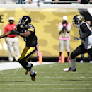 Pittsburgh Steelers wide receiver Markus Wheaton, left, can't hang on to a pass as he is defended by Jacksonville Jaguars cornerback Will Blackmon, right, during the first half of an NFL football game in Jacksonville, Fla., Sunday, Oct. 5, 2014 The Associ
