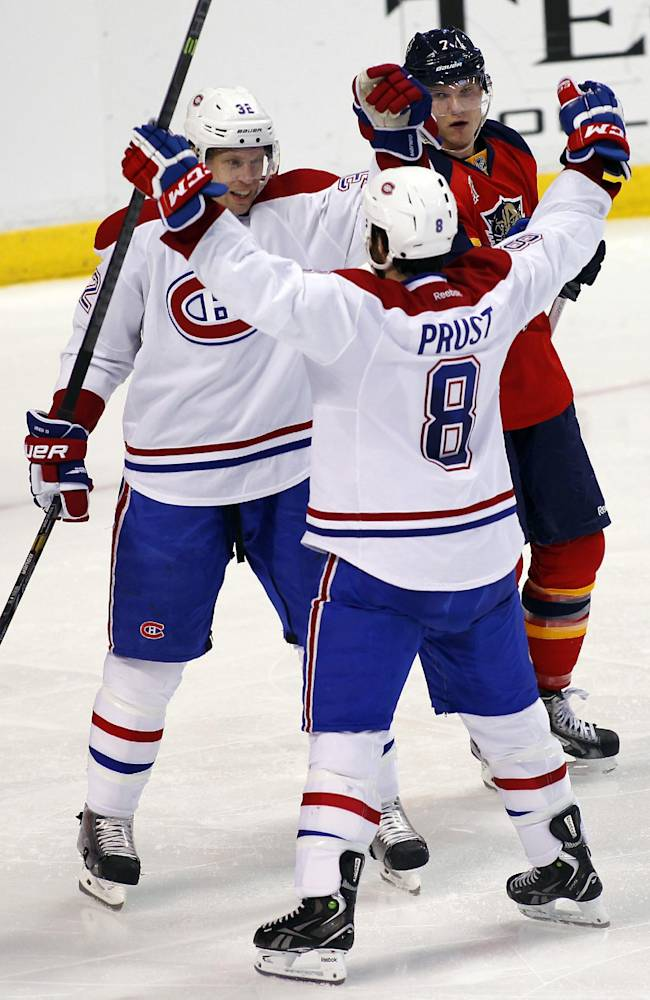 Montreal Canadiens right wing Brandon Prust (8) celebrates with teammate Travis Moen (32) after scoring a goal during the second period of an NHL hockey game against the Florida Panthers in Sunrise, Fla., Sunday, Dec. 29, 2013