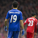 Chelsea's Diego Costa sports a torn shirt during the English Premier League soccer match between Liverpool and Chelsea at Anfield Stadium, Liverpool, England, Saturday Nov. 8, 2014