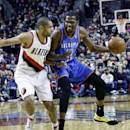 Oklahoma City Thunder forward Kevin Durant, right, drives on Portland Trail Blazers forward Nicolas Batum, from France, during the first half of an NBA basketball game in Portland, Ore., Wednesday, Dec. 4, 2013. (AP Photo/Don Ryan)