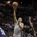 San Antonio Spurs' Tony Parker (9), of France, goes up for a shot during the first half in Game 2 of the Western Conference finals NBA basketball playoff series against the Memphis Grizzlies, Tuesday, May 21, 2013, in San Antonio. (AP Photo/Eric Gay)