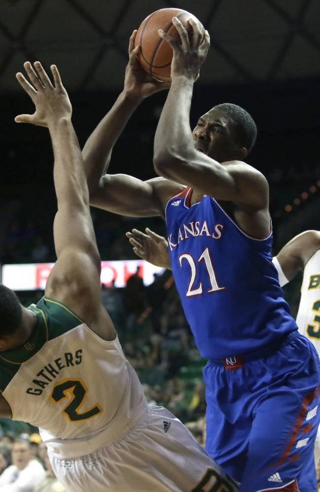 Baylor's Rico Gathers (2) is knocked backwards by Kansas' Joel Embiid (21) during a shot attempt as Baylor's Cory Jefferson (34) watches in the first half of an NCAA college basketball game, Tuesday, Feb. 4, 2014, in Waco, Texas. Embiid was charged with a foul on the play