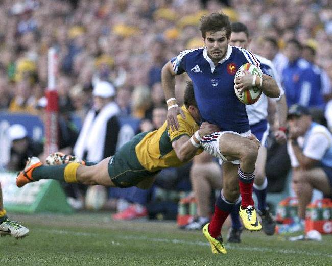 France's Hugo Bonneval is tackled by Australia's Adam Ashley-Cooper during their rugby test match in Sydney Saturday, June 21, 2014