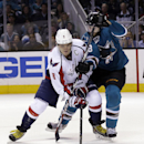 Washington Capitals' Alex Ovechkin (8), of Russia, takes a shot next to San Jose Sharks' Brent Burns during the second period of an NHL hockey game Saturday, March 22, 2014, in San Jose, Calif The Associated Press