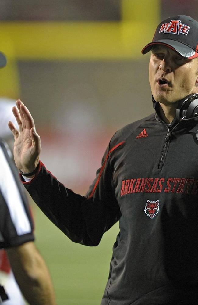 AP source: Boise State hires Bryan Harsin as coach