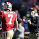 San Francisco 49ers head coach Jim Harbaugh, right, tosses the football to 49ers quarterback Colin Kaepernick (7) during warmups before an NFL football game against the Seattle Seahawks, Sunday, Dec. 8, 2013, in San Francisco The Associated Press