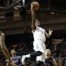 Miami guard Deandre Burnett (1) shoots over South Alabama guard Taishaun Johnson and guard Luka Andjusic (33) in the first half of an NCAA college basketball game, Friday, Nov. 28, 2014, in Coral Gables, Fla. (AP Photo/Lynne Sladky)