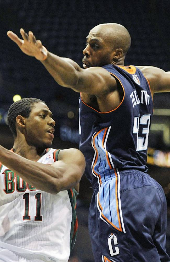 Milwaukee Bucks' Brandon Knight (11) drives to the basket around Charlotte Bobcats' Anthony Tolliver during the second half of an NBA basketball game Saturday, Oct. 12, 2013, in Milwaukee. The Bobcats defeated the Bucks 83-76