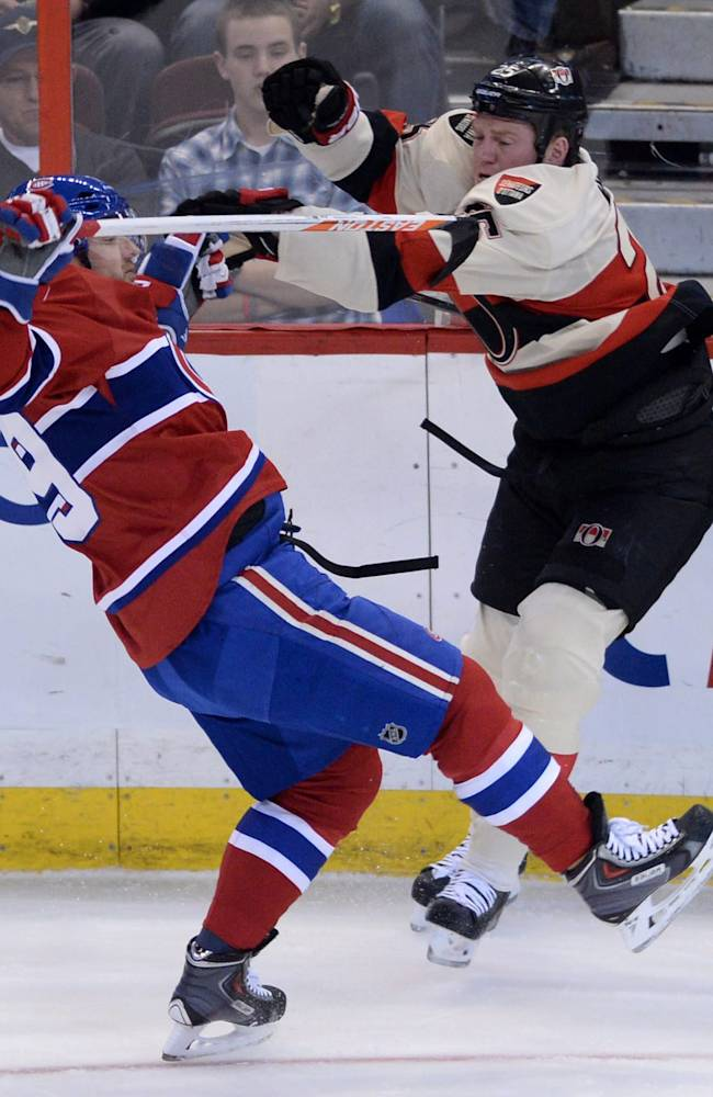 CORRECTS DATE TO FRIDAY APRIL 4 - CORRECTS DATE TO FRIDAY APRIL 4Ottawa Senators forward Chris Neil, right, and Montreal Canadiens defenseman Andrei Markov collide during first period NHL hockey action in Ottawa on Friday, April 4, 2014