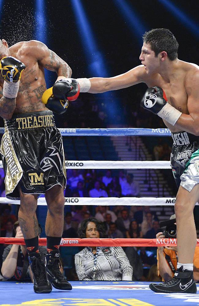 Pablo Cesar Cano, right, lands a punch against Ashley Theophane during a welterweight fight, Saturday, Sept. 14, 2013, in Las Vegas