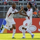 Cuba's Ariel Pedro Martizez, left, celebrates with Yoel Colome after scoring his second goal goal against Belize, during the second half of a CONCACAF Gold Cup soccer match Tuesday, July 16, 2013, in East Hartford, Conn. Cuba won 4-0. (AP Photo/Fred Beckham)