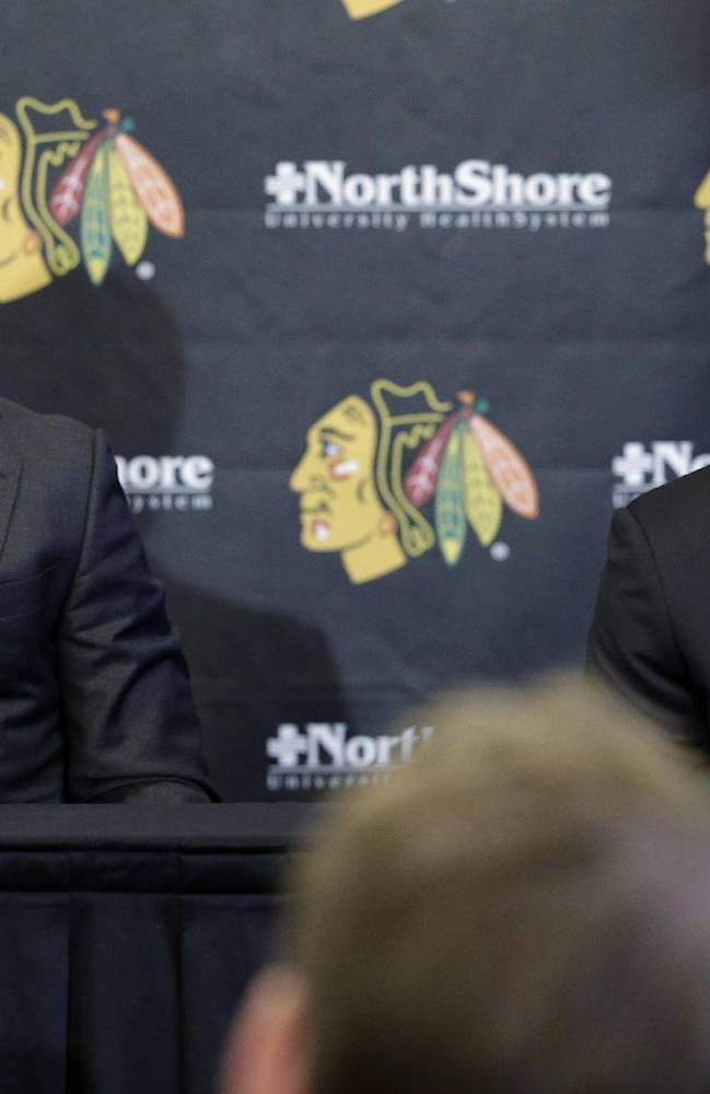 Chicago Blackhawks' Patrick Kane, right, speaks as Jonathan Toews listens during a news conference at the United Center in Chicago, Wednesday, July 16, 2014. The Blackhawks recently agreed to eight-year contract extensions with Toews and Kane