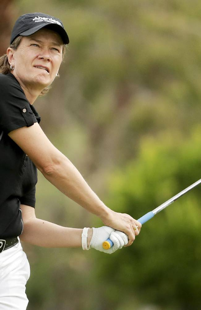Catriona Matthew, of Scotland, watches her tee shot on the 11th hole during the second round at the Kraft Nabisco Championship golf tournament Friday, April 4, 2014, in Rancho Mirage, Calif