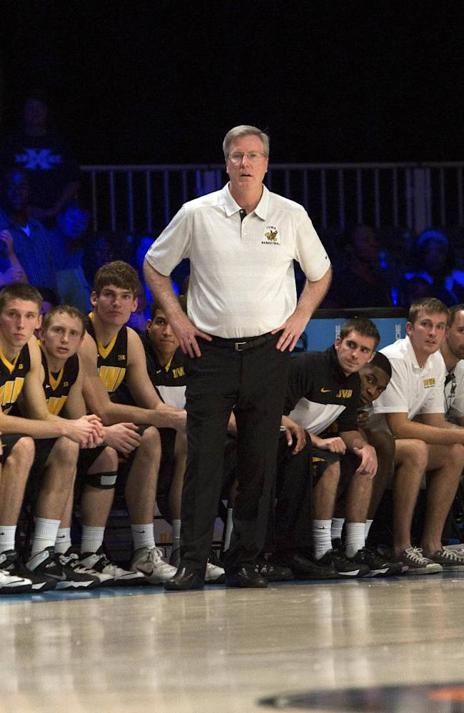 Iowa head coach Fran McCaffery watches from the sidelines the second half of an NCAA college basketball game against Xavier in Paradise Island, Bahamas, Thursday, Nov. 28, 2013. Iowa won 77-74 in overtime