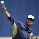 Milwaukee Brewers' Yovani Gallardo warms up for the Brewers' exhibition baseball game against the Oakland Athletics on Wednesday, March 5, 2014, in Phoenix The Associated Press